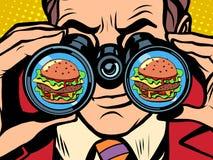 O homem com fome quer um hamburguer Foto de Stock Royalty Free