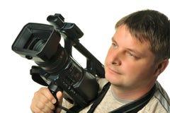 O homem com um vídeo câmera Fotos de Stock