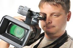 O homem com um vídeo câmera fotografia de stock royalty free