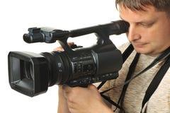 O homem com um vídeo câmera Imagem de Stock Royalty Free