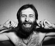 O homem com uma barba grande e os bigodes fotos de stock royalty free