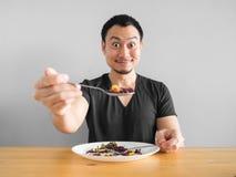 O homem come o alimento saudável Foto de Stock