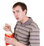 O homem come fritadas francesas Imagem de Stock Royalty Free