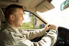 O homem conduz o carro Imagem de Stock Royalty Free