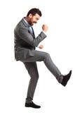 O homem considerável entusiasmado com braços aumentou no sucesso fotos de stock royalty free