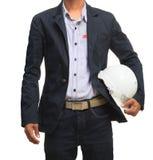 O homem da engenharia e o capacete de segurança novos isolaram o branco Imagens de Stock Royalty Free