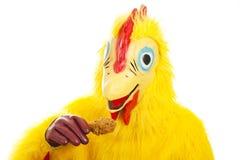O homem da galinha come o pilão Foto de Stock Royalty Free