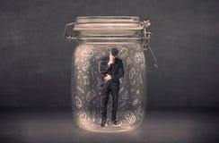 O homem de negócio capturou no frasco de vidro com ícones tirados mão c dos meios Imagem de Stock Royalty Free