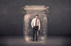 O homem de negócio capturou no frasco de vidro com ícones tirados mão c dos meios Fotografia de Stock Royalty Free