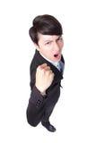 O homem de negócio considerável com braços aumentou no sucesso Fotos de Stock Royalty Free