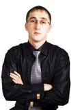 O homem de negócio está em uma camisa preta Imagem de Stock