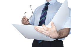 O homem de negócio está lendo Imagem de Stock
