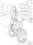 O homem de negócio monta uma bicicleta Foto de Stock Royalty Free