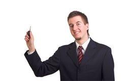 O homem de negócio mostra a chave do carro Fotografia de Stock Royalty Free