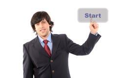 O homem de negócio novo pressiona a tecla 'Iniciar Cópias' Imagem de Stock Royalty Free
