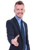 O homem de negócio oferece o aperto de mão Imagem de Stock Royalty Free