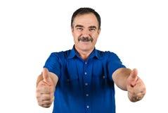 O homem de negócio sênior dá os polegares acima Fotografia de Stock Royalty Free