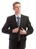 O homem de negócios abotoa seu terno Fotografia de Stock Royalty Free