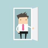 O homem de negócios abre a porta ilustração do vetor