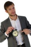 Homem de negócios e despertador Fotografia de Stock Royalty Free