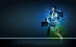 O homem de negócios alegre talentoso que salta com energia de incandescência alinha Fotografia de Stock Royalty Free