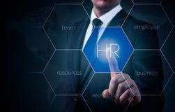 O homem de negócios aponta à ícone-hora, ao recrutamento e ao conceito escolhido imagens de stock