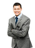 O homem de negócios asiático arma o sorriso dobrado Fotografia de Stock
