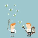 O homem de negócios atrai o dinheiro Fotografia de Stock Royalty Free