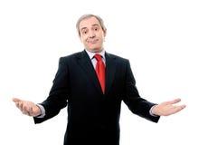 O homem de negócios bem sucedido com braços abre Fotos de Stock