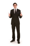 O homem de negócios bem sucedido que dá um dobro manuseia acima Foto de Stock