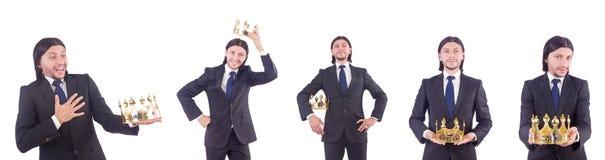 O homem de negócios com a coroa isolada no branco Imagens de Stock Royalty Free