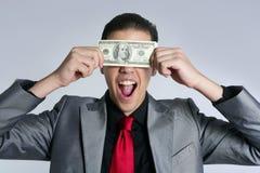 O homem de negócios com dólar anota o terno e o laço fotografia de stock