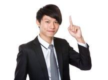 O homem de negócios com dedo aparece Imagem de Stock