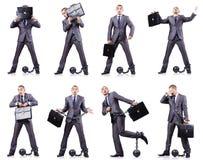 O homem de negócios com os grilhões no branco Fotografia de Stock Royalty Free