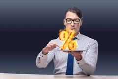 O homem de negócios com por cento assina dentro o conceito alto do interesse Imagem de Stock