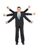O homem de negócios com seis mãos mostra a aprovação do gesto Fotografia de Stock