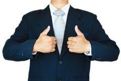 O homem de negócios com terno e a mão da ação assinam planeando o trabalho Conceito do negócio com povos e vida moderna na cidade Foto de Stock