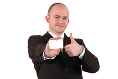 O homem de negócios com um cartão que levanta com polegares levanta o sinal Imagens de Stock Royalty Free