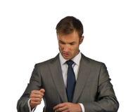O homem de negócios corrige um terno fotos de stock royalty free