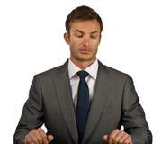 O homem de negócios corrige um terno fotografia de stock