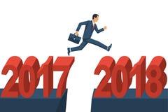 O homem de negócios do homem salta desde 2017 até 2018 Imagens de Stock Royalty Free