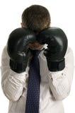 O homem de negócios do vencido cobre suas luvas de encaixotamento da face Imagens de Stock Royalty Free