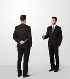 O homem de negócios dois agita as mãos Imagem de Stock