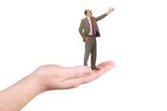 O homem de negócios em uma palma Fotografia de Stock Royalty Free
