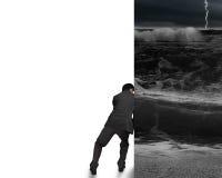 O homem de negócios empurra afastado a parede tormentoso do oceano Fotos de Stock Royalty Free