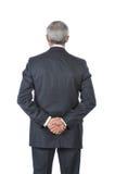 O homem de negócios ereto com mãos atrás suporta fotografia de stock royalty free