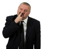 O homem de negócios escolhe o nariz foto de stock royalty free