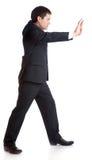O homem de negócios está empurrando algo Foto de Stock Royalty Free