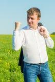 O homem de negócios expressa seus sentimentos com gestos Imagem de Stock