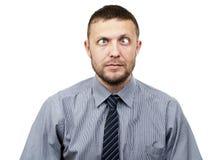 O homem de negócios farpado engraçado faz os olhos engraçados fotos de stock royalty free